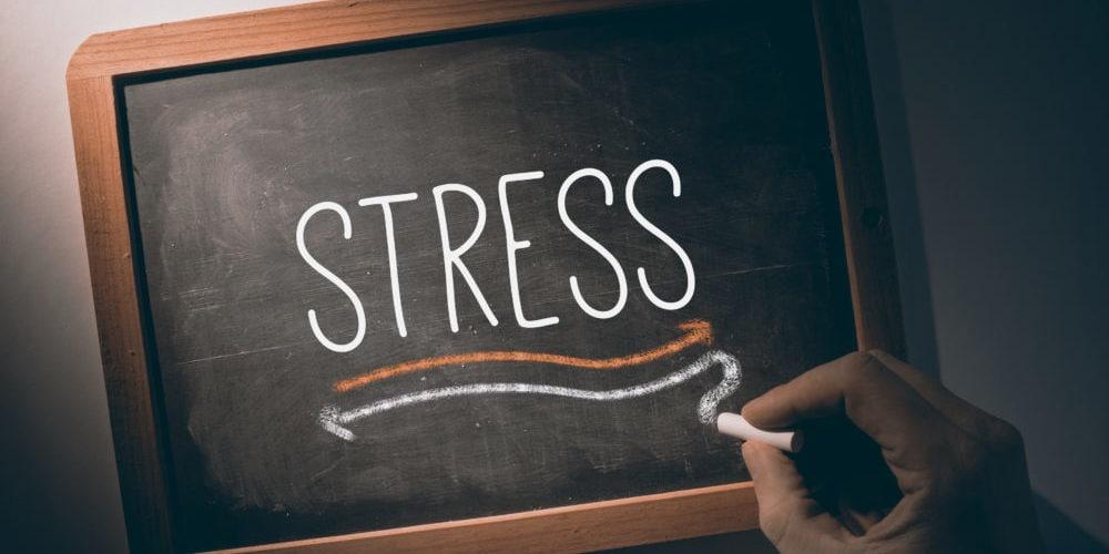 Hand writing Stress on chalkboard