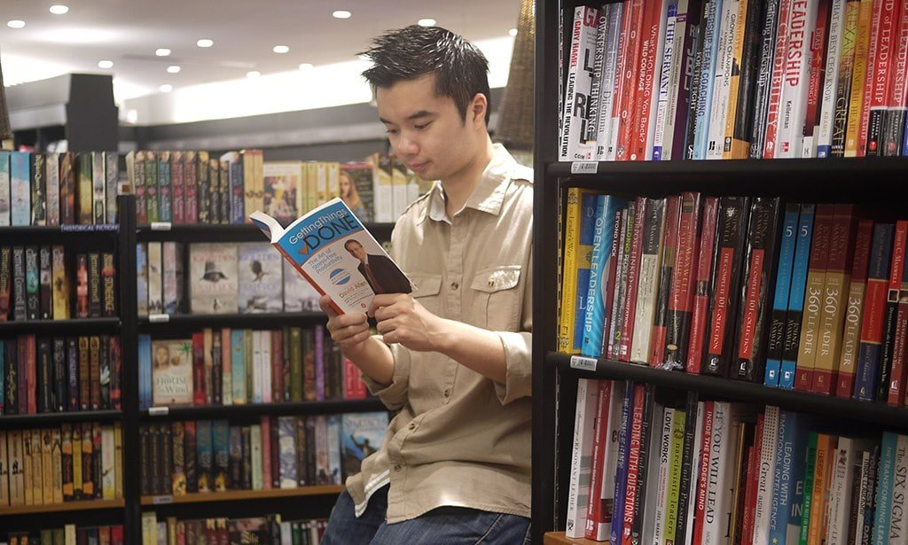 Thanh holding the GTD book